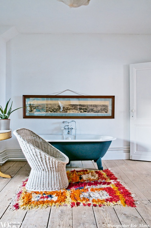 Colour is injected into this bathroom through the placement of a bright orange and pink shag rug in front of the freestanding bathtub.  From 'Big Ideas', a story on page 162 of Vogue Living MayJune 2012.  Photograph by Eric Morin.